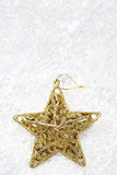 The gold star on snow for decoration christmas Royalty Free Stock Photography