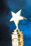 Gold star trophy Royalty Free Stock Photography