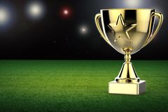 Gold star trophy on soccer field background