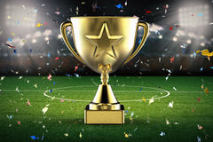 Gold star trophy with soccer stadium Royalty Free Stock Photos