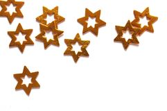 Gold stars. Wooden gold stars isolated on white background Royalty Free Stock Photos