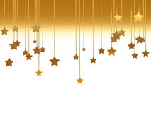 Gold stars. Ornaments with gold stars hanging Stock Image