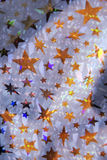 Gold stars. Shiny metallic foil texture with gold and blue stars. A crinkled red metallic texture makes an excellent background, layer, mask, or texture Stock Photography