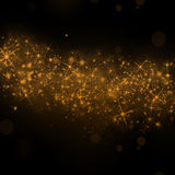Gold stars background. Gold glittering stars dust trail background Stock Image