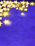 Gold stars over blue background Stock Photo