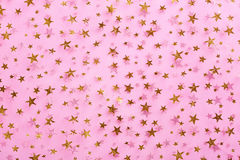 Gold stars on pink textile Royalty Free Stock Photography
