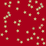 Gold stars on red background Stock Photography