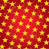 Gold Stars on Red Background Holiday grunge. Pattern Royalty Free Stock Photography