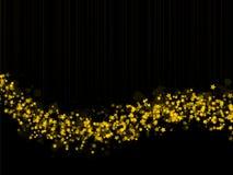 Gold stars trail. On black background Stock Image