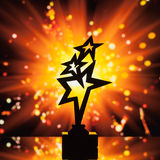 Gold stars trophy silhouette against shiny background Royalty Free Stock Images