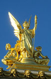 Gold statue of an angel on a catholic cathedral roof Stock Photo