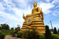 The gold statue of Big Buddha over blue sky Stock Images
