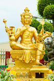 Gold statue of Brahma. Statuette of hindu god royalty free stock photos