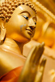 Gold statue of Buddha in Mae Sot province, Thailand. Royalty Free Stock Image