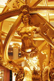 Gold statue. In casino of Macau stock photography