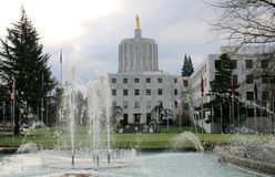 Oregon State Capitol. Gold statue `Oregon Pioneer` atop of the Capitol Building`s dome in Salem, Oregon royalty free stock images