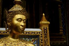 Gold statue. An ornamental statue in Bangkok Stock Image