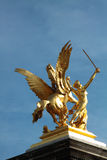 Gold statue, Paris, France. Close up of gold statue of warrior with winged horse against blue skies in Paris, France Royalty Free Stock Photos