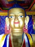 Gold statue of seated Shakyamuni Buddha at Shey Palace. Royalty Free Stock Photo