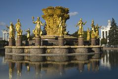 Gold statues. At the lake (all russian exhibition centre Stock Image