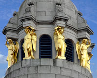Gold statues. On a building royalty free stock images