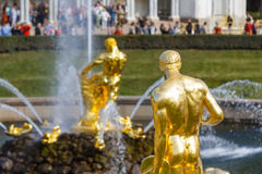 Gold statues and fountains in Peterhof castle Royalty Free Stock Photos