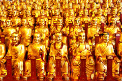 Gold statues of the Lohans Royalty Free Stock Image