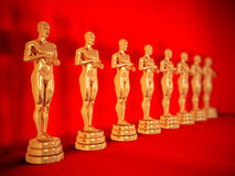 Gold statues on red. Stock Photo