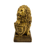 Gold statuette of a lion with shield isolated on a white background Royalty Free Stock Photo