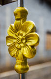 Gold steel flower on the door stock photography