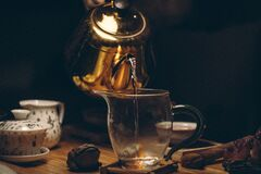 Gold Steel Kettle Beside Clear Glass Pitcher Royalty Free Stock Photos