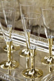 Gold stemmed champagne glasses Stock Photos