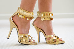 Gold Stiletto Shoes Royalty Free Stock Photography