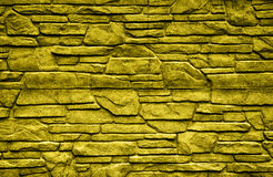 Gold stone brick wall detailed contrast texture Royalty Free Stock Photo