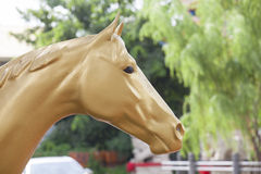 Gold stone horse Royalty Free Stock Images