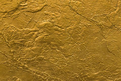 Gold stone wall texture Royalty Free Stock Photo
