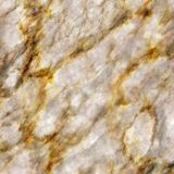 Gold Streaked Marble Texture. A seamless precious marble texture with gold veins Stock Photo