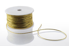 Gold string spool Royalty Free Stock Images