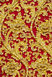 The gold stucco design of native thai style on the. Wall of Thailand stock photo