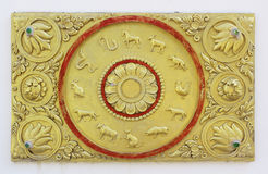 The gold stucco design of native Thai style on the Wall. Royalty Free Stock Photos