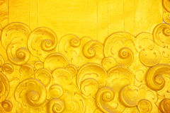 The gold stucco design of native thai style on the Wall. For background Stock Photos