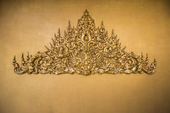 Gold stucco Thai style Royalty Free Stock Image