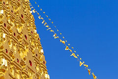 Gold stupa and line flag Stock Photo