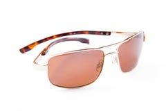 Gold sun glasses. On white stock images