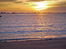 Gold sun light and stone seaside in Thailand Royalty Free Stock Photos