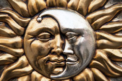 Sun and moon. Gold sun and silver moon in the same symbol Royalty Free Stock Photos
