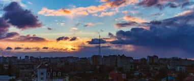 Gold sunrise dramatic sky city. Gold sunrise and dramatic sky over the city of Ivano-Frankivsk, Ukraine Royalty Free Stock Image