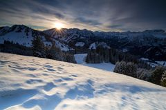 Sunrise over snowy mountains. Gold sunrise over snowy mountains Stock Image