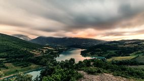 Gold sunset on mountain lake landscape timelapse. Dramatic sky stock video