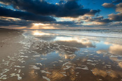 Gold sunset on North sea beach stock photo